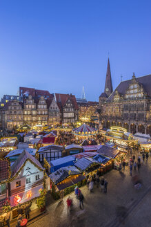 Germany, Bremen, Christmas market on market square in the evening seen from above - PVCF01063