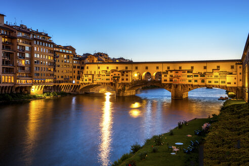 Italy, Tuscany, Florence, view to Arno River and lighted Ponte Vecchio at blue hour - PUF00611
