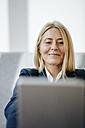 Portrait of smiling blond businesswoman - JOSF00710