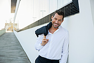 Portrait of confident relaxed businessman outdoors - CHAF01857