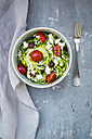Bowl of zucchini spaghetti with feta, cherry tomatoes and black olives - LVF05979