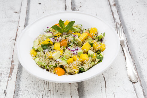 Plate of quinoa salad with mango, avocado, tomatoes, cucumber, herbs and black sesame - LVF05988