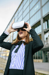 Businesswoman using VR goggles - DAPF00637