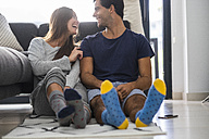 Happy young couple relaxing at home - SIPF01557