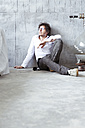 Architect sitting on the floor at construction site - REAF00223