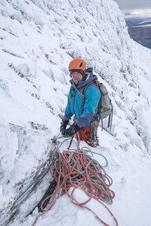 Scotland, Anoach Mor, Man ice climbing in winter - ALRF00899