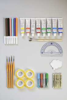 Top view of protractor, sticky tape and artist's supplies - MOMF00038