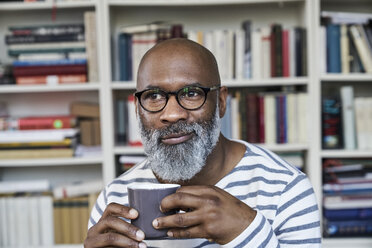 Mature man enjoying a cup of coffee - FMKF03759