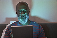 Mature man using digital tablet - FMKF03774