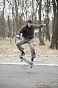 Skateboarder doing a trick - MOMF00054