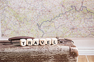 Old suitcase, map and word travel made with alphabet cubes - CMF00679