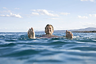 Relaxed mature man floating in the sea - PDF01085