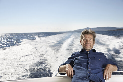 Portrait of content mature man on his motor yacht - PDF01094