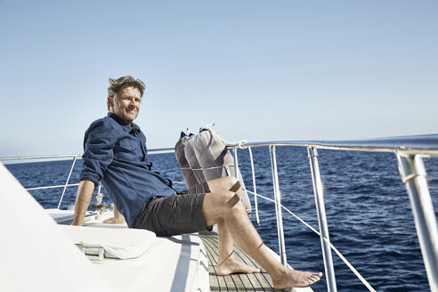 Relaxed mature man sitting on his motor yacht - PDF01115