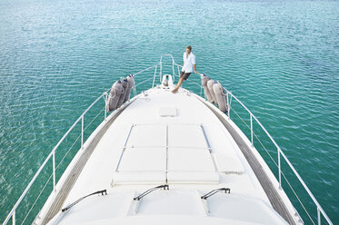 Mature man on deck of his motor yacht - PDF01121