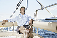 Portrait of mature man relaxiing on his sailing boat - PDF01142