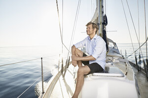 Smiling mature man relaxing on his sailing boat - PDF01160