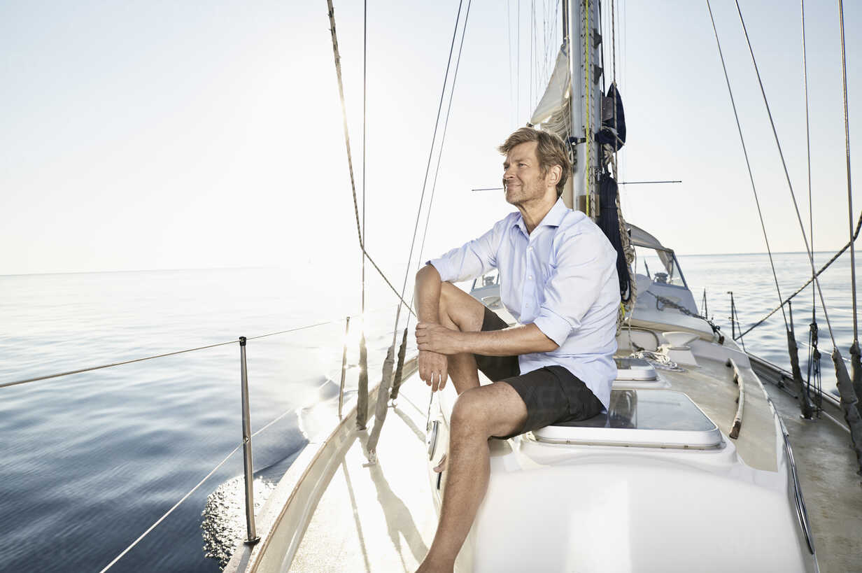 Smiling mature man relaxing on his sailing boat - PDF01160 - Philipp Dimitri/Westend61