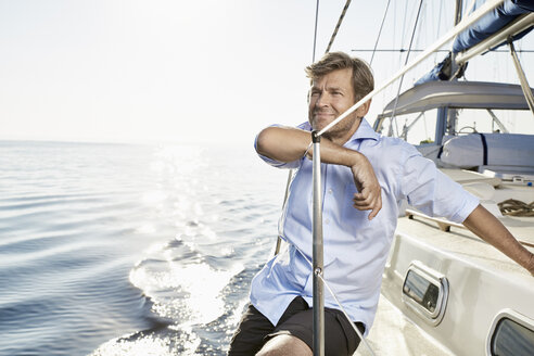 Portrait of smiling mature man on his sailing boat - PDF01166