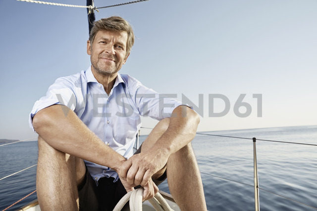 Portrait of smiling mature man sitting on his sailing boat - PDF01172 - Philipp Dimitri/Westend61
