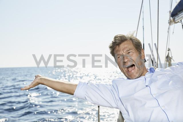 Portrait of screaming man on his sailing boat - PDF01187 - Philipp Dimitri/Westend61