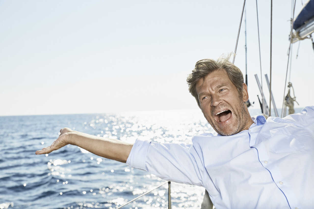Portrait of screaming man on his sailing boat - PDF01187 - Philipp Dimitri/Westend61