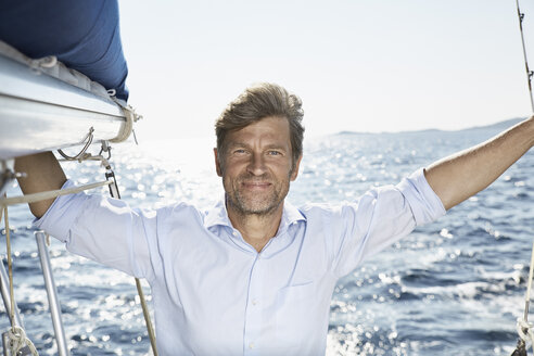 Portrait of smiling mature man on sailing boat - PDF01193