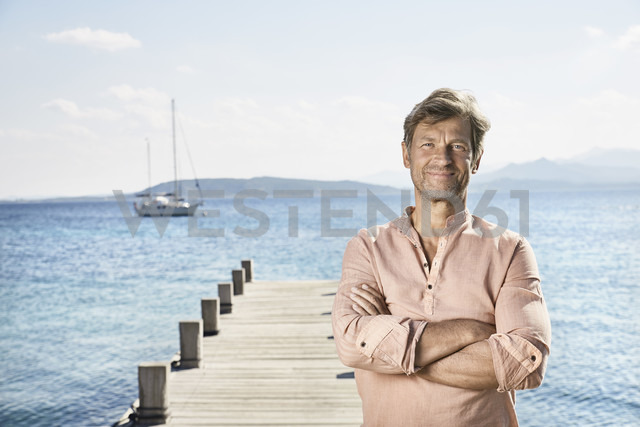 Portrait of smiling mature man standing on jetty - PDF01199 - Philipp Dimitri/Westend61