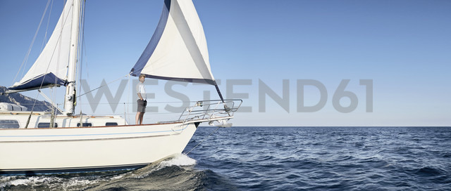 Mature man standing on his sailing boat looking at distance - PDF01217 - Philipp Dimitri/Westend61