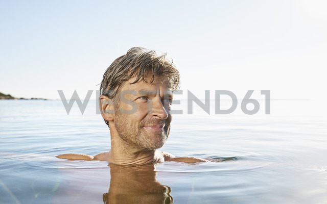 Portrait of smiling man bathing in the sea - PDF01226 - Philipp Dimitri/Westend61