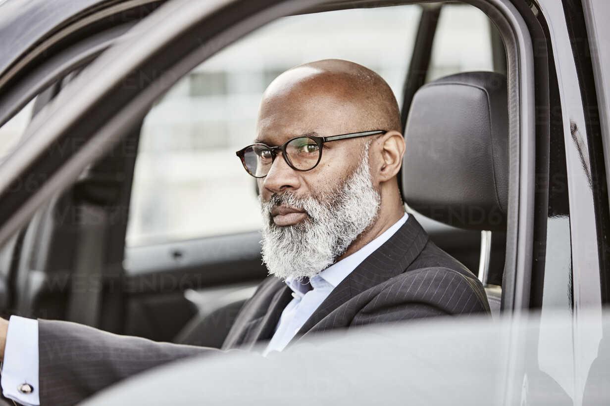 Businessman driving a car - FMKF03800 - Jo Kirchherr/Westend61