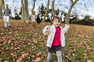 Portrait of happy little girl running on a hill in autumn - MGOF03211