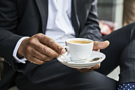Man sitting in cafe, drinking coffee - FMKF03849