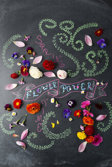 Word Flower Power and blossoms on blackboard - MYF01898