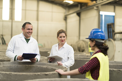 Chemists in concrete factory doing a quality check - JASF01589