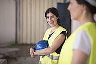 Women working together in concrete factory - JASF01628