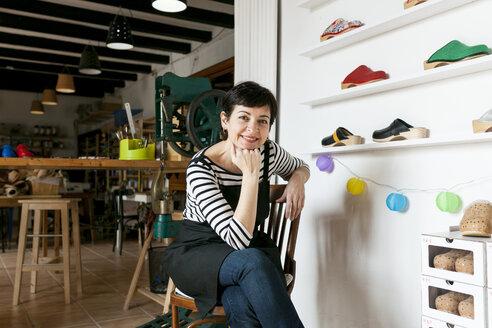 Portrait of confident clogmaker in her workshop - VABF01323
