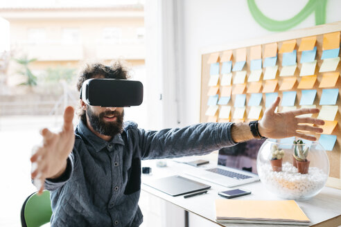 Man wearing Virtual Reality Glasses  working on new project - JRFF01308
