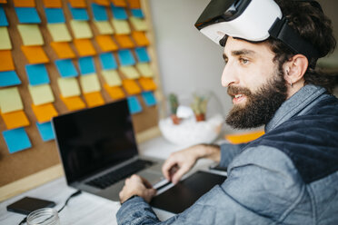 Man with Virtual Reality Glasses working on new project in his office - JRFF01314