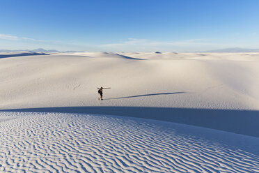 USA, New Mexico, Chihuahua Desert, White Sands National Monument, photographer on dune - FOF09209