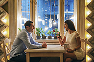 Young couple in a restaurant at Valentine's Day - MOMF00085