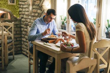 Couple having dinner in a restaurant - MOMF00103