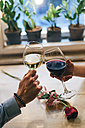 Couple toasting with wine, close-up - MOMF00109