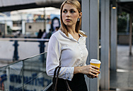 Portrait of businesswoman with coffee to go - MOMF00121