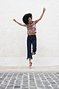 Young woman jumping in the air - KKAF00703