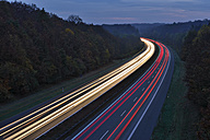 Germany, Bavaria, Traffic light trails on motorway at twilight - RUEF01783