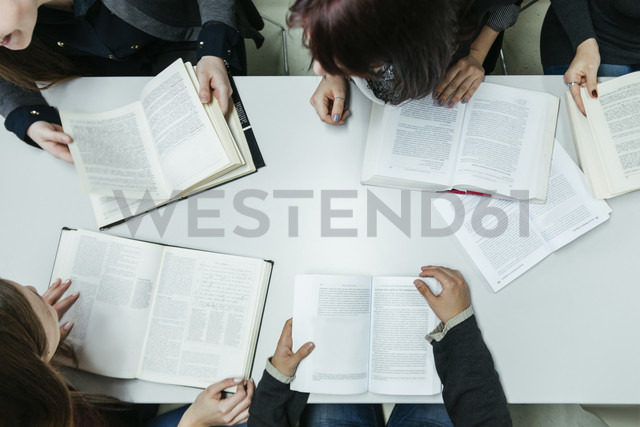 Group of students learning together in a library - ZEDF00588