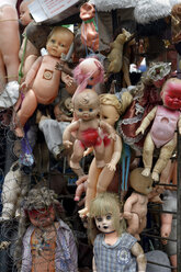 Columbia, Bogota, Used dolls on the gate of a waste collector - FLKF00800