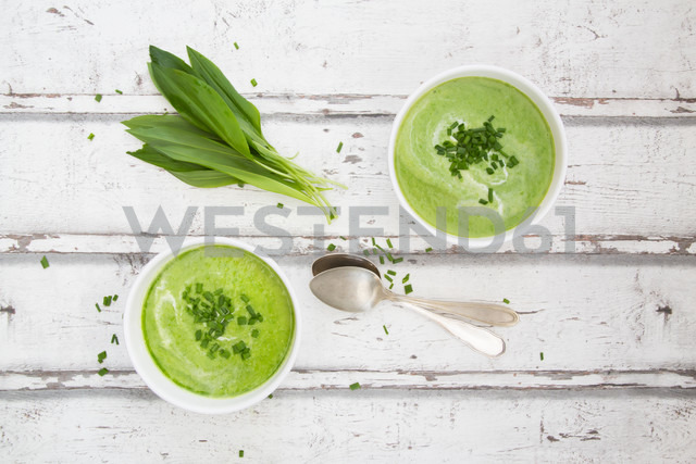 Two bowls of ramson soup garnished with chives and cream - LVF06045