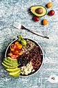 Lunch bowl of quinoa tricolore, chard, avocado, carrot spaghetti, tomatoes and feta - SARF03288